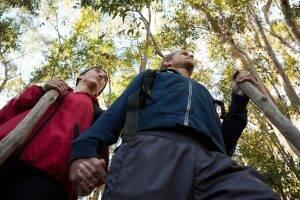 hiker-couple-walking-in-forest-J78K6YT-300x200