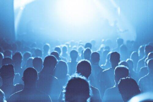 blue-ambiance-and-crowd-in-silhouette-during-a-P6EZVCZ-1024x683