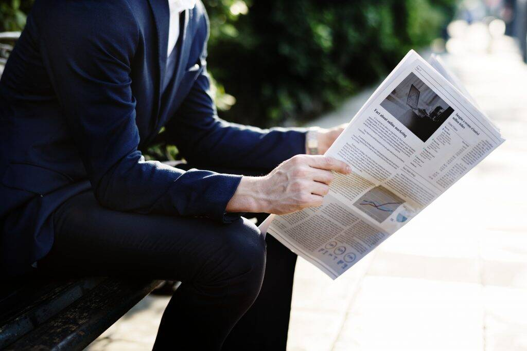 businessman-reading-newspaper-in-the-morning-PTC3YEK-1024x683