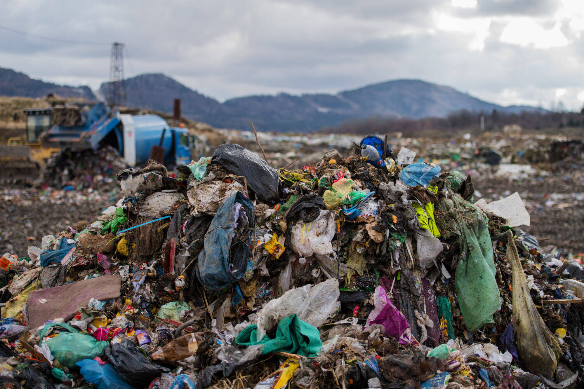 Waste heaps on landfill, environmental concept. Copy space.